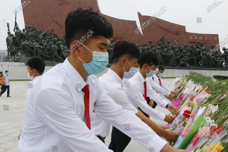 Pyongyang citizens visit Mansu Hill to pay homage to the bronze statues of President Kim Il Sung and Chairman Kim Jong Il ahead of the 27th anniversary of the death of President Kim Il Sung, in Pyongyang, North Korea, on
