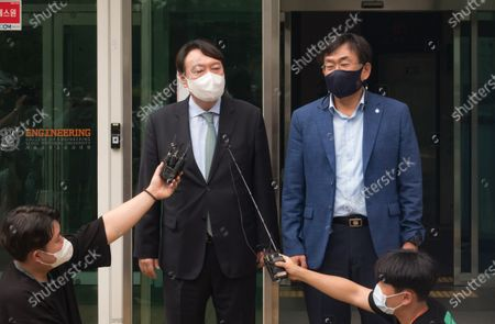 South Korean former Prosecutor General Yoon Seok-Youl (L), who has announced his intention to run in next year's presidential election as an opposition candidate, arrives with professor Joo Han-Kyu (R) to attend a press conference at Seoul National University. South Korean President Moon Jae-In selected Yoon in July 2019 to lead the national prosecution service but Yoon later clashed with president Moon government's justice ministers over a prosecution reform drive which was one of Moon's major presidential election pledges. Yoon stepped down as prosecutor general in early March 2021. Yoon is one of leading candidates for the next presidential election of South Korea.