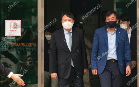 South Korean former Prosecutor General Yoon Seok-Youl (C), who has announced his intention to run in next year's presidential election as an opposition candidate, arrives with professor Joo Han-Kyu (front R) to attend a press conference at Seoul National University. South Korean President Moon Jae-In selected Yoon in July 2019 to lead the national prosecution service but Yoon later clashed with president Moon government's justice ministers over a prosecution reform drive which was one of Moon's major presidential election pledges. Yoon stepped down as prosecutor general in early March 2021. Yoon is one of leading candidates for the next presidential election of South Korea.