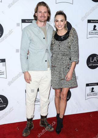 Stock Picture of Josh Pence and Elizabeth Chambers arrive at the Los Angeles Art Show 2020 Opening Night Gala held at the Los Angeles Convention Center on February 5, 2020 in Los Angeles, California, United States.