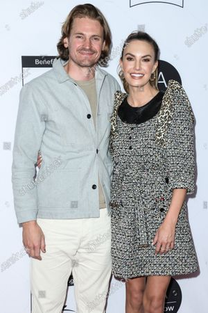 Stock Image of Josh Pence and Elizabeth Chambers arrive at the Los Angeles Art Show 2020 Opening Night Gala held at the Los Angeles Convention Center on February 5, 2020 in Los Angeles, California, United States.