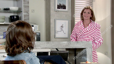 Stock Photo of Coronation Street - Ep 10381 Monday 19th July 2021 - 2nd Ep Leanne Battersby, as played by Jane Danson, instructs Sam Blakeman, as played by Jude Riordan, to put his posters back on the wall as Oliver's old bedroom is now his and she wants him to feel at home.