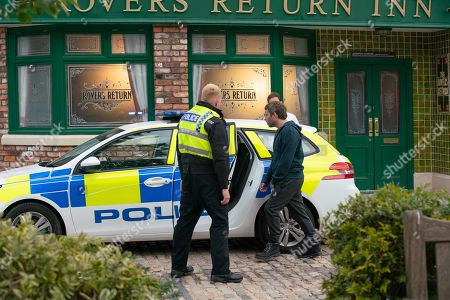 Coronation Street - Ep 10377 Wednesday 14th July 2021 - 2nd Ep Billy Mayhew and Todd Grimshaw watch as Craig Tinker, as played by Colson Smith, manhandles an angry Paul Foreman, as played by Peter Ash, into a police car.