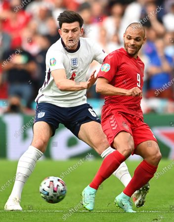 Harry Maguire (L) of England in action against Martin Braithwaite (R) of Denmark during the UEFA EURO 2020 semi final between England and Denmark in London, Britain, 07 July 2021.