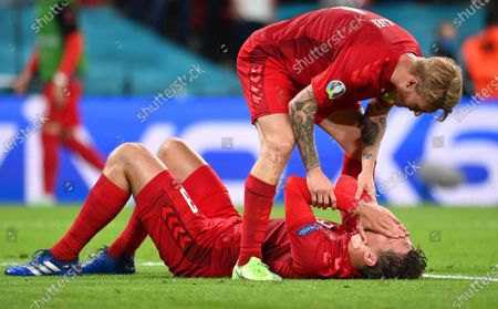 Danish players Jannik Vestergaard (bottom) and Simon Kjaer (up) react during the UEFA EURO 2020 semi final between England and Denmark in London, Britain, 07 July 2021.