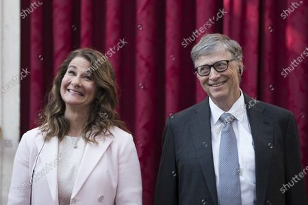 Philanthropist and co-founder of Microsoft, Bill Gates, right, and his wife Melinda react, prior to being awarded the Legion of Honour at the Elysee Palace in Paris. Bill Gates and Melinda French Gates will continue to work together as co-chairs of their foundation even after their planned divorce. However, if after two years they cannot continue in their roles, French Gates will resign her positions as co-chair and trustee, The Bill and Gates Melinda Foundation announced
