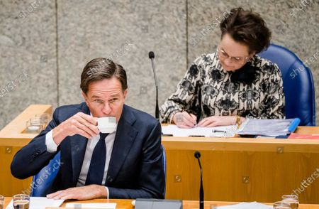 Outgoing Prime Minister Mark Rutte and outgoing State Secretary Alexandra van Huffelen of Finance during a debate in the House of Representatives about the childcare benefits report and the resignation of the cabinet in The Hague, the Netherlands, 07 July 2021.