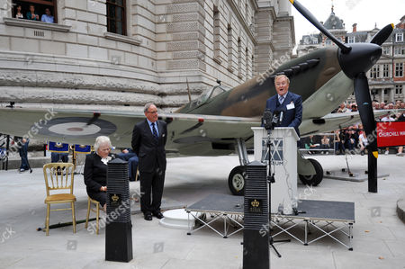 Actor Robert Hardy reading Churchill's rousing and iconic speech in front of a 1940 Mk I Spitfire as Lady  Soames (Winston Churchill's daughter) looks on