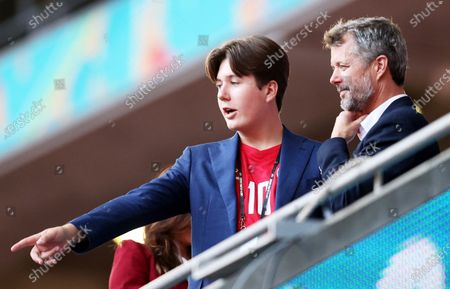 Frederik, Crown Prince of Denmark and his son Prince Christian (L) before the UEFA EURO 2020 semi final between England and Denmark in London, Britain, 07 July 2021.