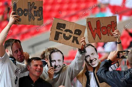 England fans pose with masks of former British Health Seceratary Matt Hancock before the UEFA EURO 2020 semi final between England and Denmark in London, Britain, 07 July 2021.