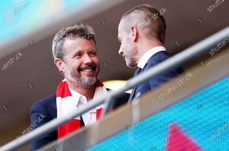 Crown Prince Frederik of Denmark, talks to UEFA president Aleksander Ceferin (L) before the UEFA EURO 2020 semi final between England and Denmark in London, Britain, 07 July 2021.