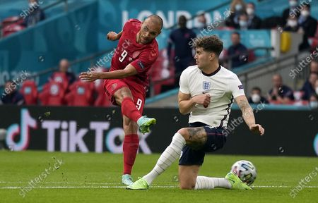 Martin Braithwaite (L) of Denmark in action against John Stones of England during the UEFA EURO 2020 semi final between England and Denmark in London, Britain, 07 July 2021.