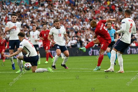 Martin Braithwaite of Denmark (2R) attempts a shot on goal during the UEFA EURO 2020 semi final between England and Denmark in London, Britain, 07 July 2021.
