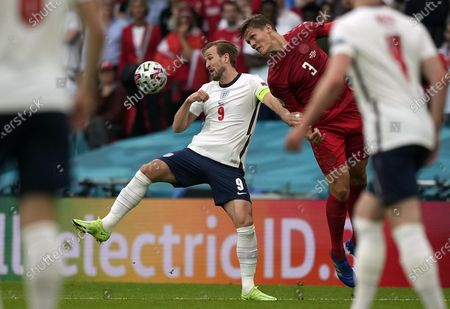 Harry Kane (L) of England in action against Jannik Vestergaard of Denmark during the UEFA EURO 2020 semi final between England and Denmark in London, Britain, 07 July 2021.