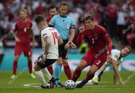 Kalvin Phillips (L) of England in action against Jannik Vestergaard (R) of Denmark during the UEFA EURO 2020 semi final between England and Denmark in London, Britain, 07 July 2021.
