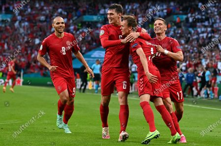 Mikkel Damsgaard of Denmark (2R) celebrates scoring the 1-0 with Jens Stryger Larsen (R), Martin Braithwaite (L) and Andreas Christensen (2L) during the UEFA EURO 2020 semi final between England and Denmark in London, Britain, 07 July 2021.