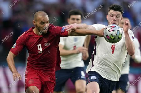 Martin Braithwaite (L) of Denmark in action against Declan Rice of England during the UEFA EURO 2020 semi final between England and Denmark in London, Britain, 07 July 2021.