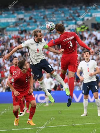 Harry Kane (L) of England goes for a header against Jannik Vestergaard of Denmark during the UEFA EURO 2020 semi final between England and Denmark in London, Britain, 07 July 2021.