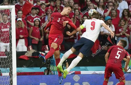 Harry Kane (C) of England in action against Jannik Vestergaard (L) of Denmark during the UEFA EURO 2020 semi final between England and Denmark in London, Britain, 07 July 2021.