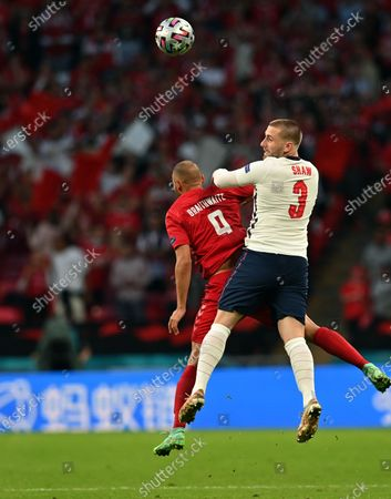 Luke Shaw of England (R) in action against Martin Braithwaite of Denmark during the UEFA EURO 2020 semi final between England and Denmark in London, Britain, 07 July 2021.