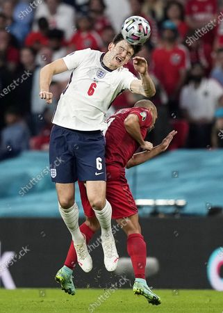 Martin Braithwaite (R) of Denmark in action against Harry Maguire of England during the UEFA EURO 2020 semi final between England and Denmark in London, Britain, 07 July 2021.