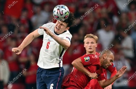 Harry Maguire of England (L) in action against Martin Braithwaite of Denmark during the UEFA EURO 2020 semi final between England and Denmark in London, Britain, 07 July 2021.