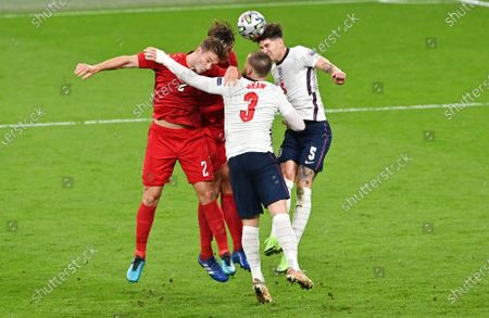 John Stones (R) and Luke Shaw of England in action against Joachim Andersen (L) and Jannik Vestergaard of Denmark during the UEFA EURO 2020 semi final between England and Denmark in London, Britain, 07 July 2021.