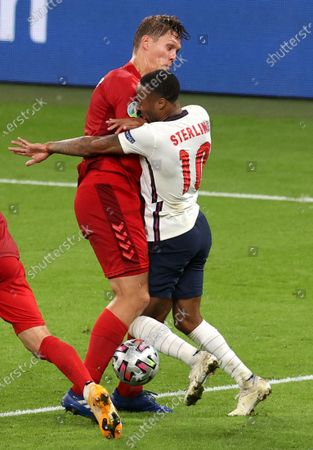 Raheem Sterling (R) of England bumps into Jannik Vestergaard of Denmark during the UEFA EURO 2020 semi final between England and Denmark in London, Britain, 07 July 2021.