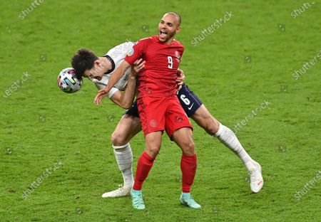Harry Maguire (L) of England in action against Martin Braithwaite of Denmark during the UEFA EURO 2020 semi final between England and Denmark in London, Britain, 07 July 2021.