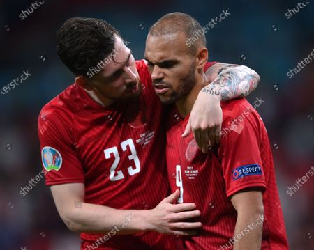 Pierre-Emile Hojbjerg (L) and Martin Braithwaite of Denmark react after losing the UEFA EURO 2020 semi final between England and Denmark in London, Britain, 07 July 2021.