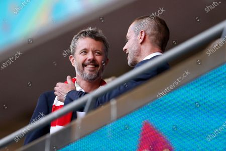 Frederik, Crown Prince of Denmark, talks with UEFA President Aleksander Ceferin, right, on the stands before the Euro 2020 soccer championship semifinal match between England and Denmark at Wembley stadium in London