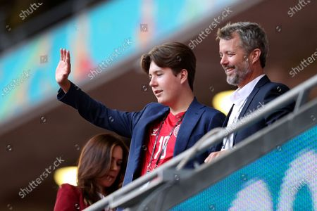 Frederik, Crown Prince of Denmark, and his son Prince Christian look from the stands before the Euro 2020 soccer championship semifinal match between England and Denmark at Wembley stadium in London