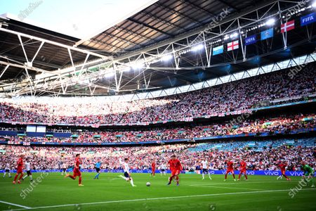 England's Mason Mount, center left, attempts a shot at goal in front of Denmark's Jannik Vestergaard during the Euro 2020 soccer semifinal match between England and Denmark at Wembley stadium in London