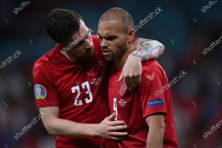 Denmark's Pierre-Emile Hojbjerg, left, confronts his teammate Martin Braithwaite at the end of the Euro 2020 soccer semifinal match between England and Denmark at Wembley stadium in London, . England won 2-1