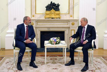 Stock Photo of Russian President Vladimir Putin (R) and Armenian acting Prime Minister Nikol Pashinyan (L) speak during their meeting in Moscow, Russia, 07 July 2021. Nikol Pashinyan is on a working visit to Moscow.