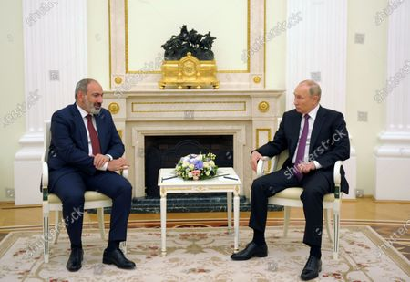 Stock Image of Russian President Vladimir Putin (R) and Armenian acting Prime Minister Nikol Pashinyan (L) speak during their meeting in Moscow, Russia, 07 July 2021. Nikol Pashinyan is on a working visit to Moscow.