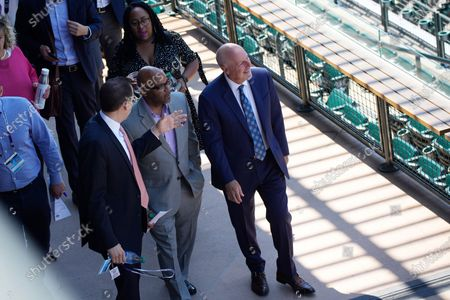 Denver Mayor Michael Hancock, front center, confers with Jeremiah Yolkut, director of events and scheduling for Major League Baseball, left, and Richard Scharf VISIT Denver president and chief executive officer, before speaking at a news conference to kick off All-Star week in Coors Field in Denver