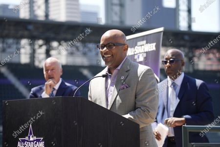 Denver Mayor Michael Hancock, front, makes a point as Richard Scharf, back left, VISIT Denver president and chief executive officer, and Michael Ford, chief operating officer of the Regional Transportation District, look on during a news conference to kick off All-Star week at Coors Field in Denver