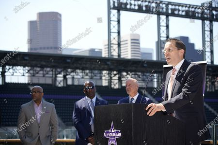 Jeremiah Yolkut, director of events and scheduling for Major League Baseball, front, makes a point as, from back left, Denver Mayor Michael Hancock, Michael Ford, chief operating officer of the Regional Transportation District, and Richard Scharf VISIT Denver president and chief executive officer, look on during a news conference to kick off All-Star week in Coors Field, in Denver