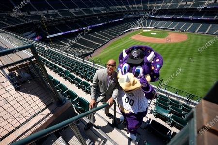 Denver Mayor Michael Hancock joins Dinger, mascot of the Colorado Rockies, for a photograph after a news conference, to kick off All-Star week in Coors Field in Denver
