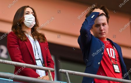Mary, Crown Princess of Denmark, looks from the stands with her son Prince Christian ahead of the Euro 2020 soccer championship semifinal between England and Denmark at Wembley stadium in London