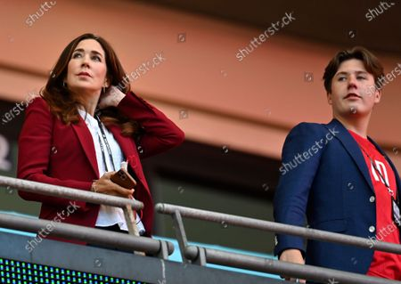 Stock Image of Mary, Crown Princess of Denmark, looks from the stands with her son Prince Christian ahead of the Euro 2020 soccer championship semifinal between England and Denmark at Wembley stadium in London
