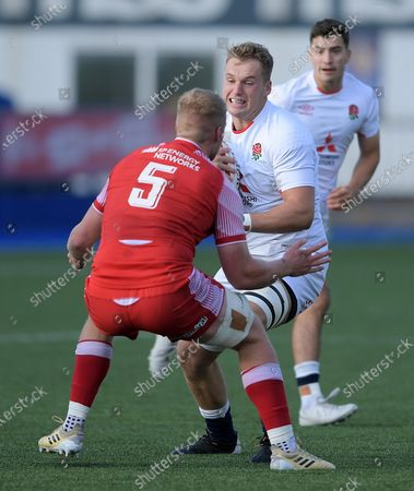 Wales vs England. Jack Clement of England is challenged by Rhys Thomas of Wales