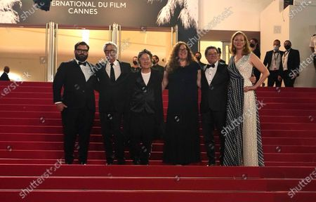 Adam Kurnitz, from left, director Todd Haynes, Christine Vachon, Julie Goldman, Christopher Clements and Carolyn Hepburn pose for photographers upon arrival at the premiere of the film 'The Velvet Underground' at the 74th international film festival, Cannes, southern France