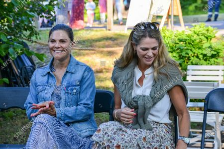 Crown Princess Victoria and Princess Madeleine of Sweden in the audience during Solliden sessions concert with Swedish artist Peter Joback at Solliden Palace in Borgholm