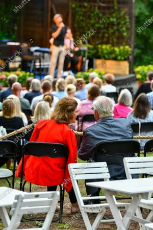 Stock Image of Queen Silvia and King Carl Gustaf of Sweden in the audience during Solliden sessions concert with Swedish artist Peter Joback at Solliden Palace in Borgholm