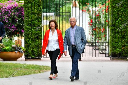 Queen Silvia and King Carl Gustaf of Sweden in the audience during Solliden sessions concert with Swedish artist Peter Joback at Solliden Palace in Borgholm