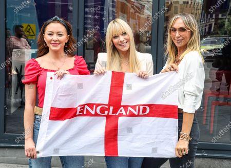 Natasha Hamilton, Jenny Frost and Liz McClarnon of Atomic Kitten are seen at Global Radio Studios in London.