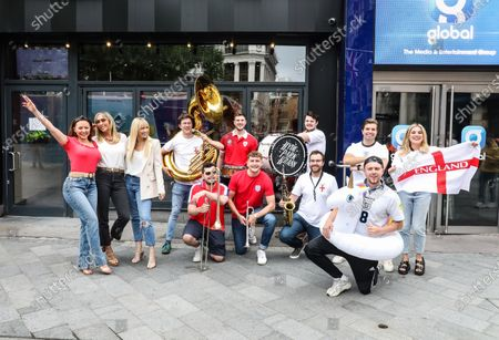 Atomic Kitten team up with brass band Hyde Park Brass and Capital Breakfast hosts Roman Kemp, Sonny Jay and Sian Welby to get the nation in the mood for England's EUROs semi-final at with a rendition of 'Whole Again' entitled 'Southgate You're the One (Football's Coming Home Again)' outside the Capital radio studios in London's Leicester Square.