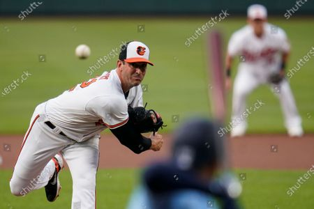 Baltimore Orioles starting pitcher Matt Harvey throws a pitch to Toronto Blue Jays leadoff batter Marcus Semien during the first inning of a baseball game, in Baltimore